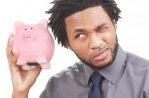 man-shaking-a-piggy-bank_19-127892